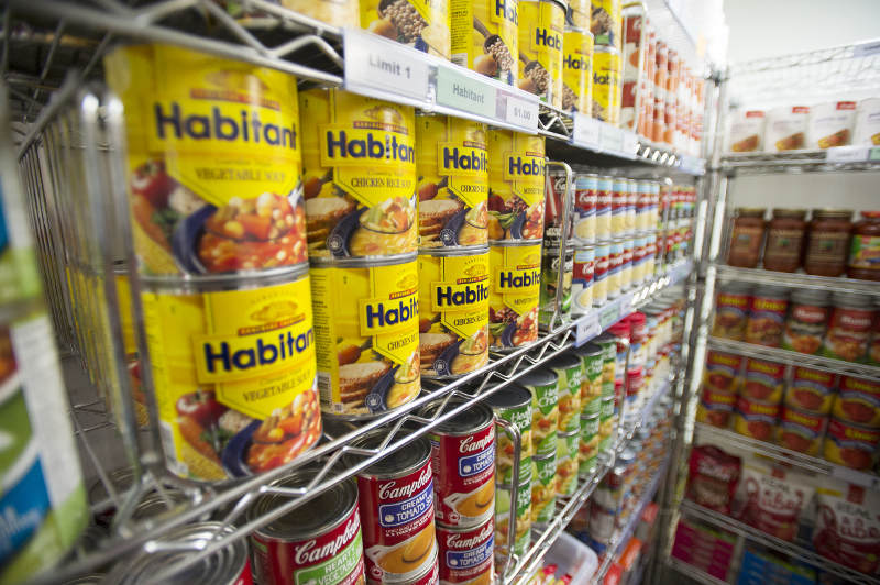 A wall of canned soup in the food bank