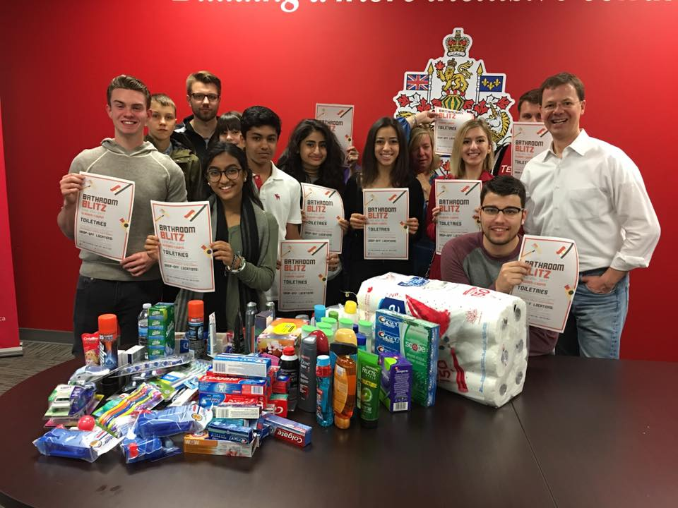 A team of people with a donation of toiletries