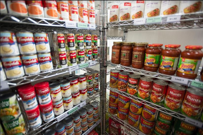 Canned soups and pasta sauces on shelves.